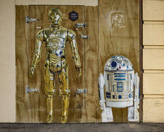 Security Guards (Steve Taylor (Photography)) Tags: door hinge city newzealand christchurch brown white streetart pasteup art metal wall paper gold robot starwars stencil sticker shiny wheatpaste guard security canterbury plastic r2d2 nz bolt southisland cbd padlock plywood c3po latch wheatup