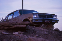 Stewart's Petrified Wood (Colton Davie) Tags: sunset arizona film car 35mm desert january slide roadtrip painteddesert magichour 2012 reversal nikon105mmf25 stewartspetrifiedwood canoneoselan7