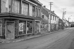 Doel III (graufuchs) Tags: street city blackandwhite monochrome town blackwhite mural europe belgium belgique belgie murals sw fujifilm monochrom deserted lr lightroom belgien doel beveren lostplace einfarbig 23mm fixedfocal fujifilmx100s