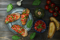 Italian fresh bruschetta with tomato, still life (breamchub) Tags: wood italy stilllife food cooking vegetables breakfast tomato bread pepper cuisine leaf healthy italian mediterranean moody dish eating spice rustic olive culture vegetable sandwich gourmet countries slice baguette snack meal vegetarian cutting oil garlic backgrounds basil material chopped appetizer cultures herb preparation seasoning freshness bruschetta roasted toasted dieting crostini antipasto foodphotography