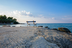 Sunset, bench and seaview (krugli) Tags: travel summer water landscape island coast rocks surf angle outdoor stones tide wide scenic greece seashore seaview zakynthos d600 sescape