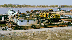 Dredges in Spring (katushang) Tags: china urban heilongjiang 35mm river boats boat spring nikon afternoon nikkor dslr dredge harbin dx haerbin songhuajiang     d5100