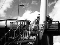Stairs (cycle.nut66) Tags: bridge blackandwhite cloud art film monochrome clouds stairs concrete four steel olympus filter micro grainy grayscale aylesbury thirds peoplesky epl1 mzuiko