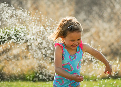 150421-girl-child-sprinklers-running.jpg (r.nial.bradshaw) Tags: girl photo nikon image creativecommons stockphoto stockphotography s11 adobecameraraw royaltyfree attributionlicense d3s fxformat rnialbradshaw oldfilmandlegacyglass nikkorbeercan 70300af456ded