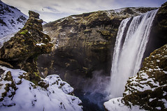 35/365 - Skgafoss Mossy Face (marisa sarto) Tags: above travel blue winter sky brown white snow cold bird nature water beautiful face birds clouds flying waterfall iceland moss south mossy s