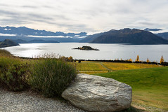 Ruby Island (Jocey K) Tags: autumn trees newzealand sky lake mountains rock clouds bench table view seat lavender scene autumncolours southisland centralotago southernalps wanaka lakewanaka ripponvineyard schist tripdownsouth rubyisland garpevines
