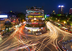 Busy Hanoi Intersection (Rob Kroenert) Tags: old city blue cars night buildings asian lights town asia long exposure downtown traffic trails motorcycles vietnam viet hour quarter intersection southeast hanoi nam