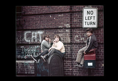 ss23-26 (ndpa / s. lundeen, archivist) Tags: people color film boys sign boston kids mailbox children graffiti sitting massachusetts nick slide mailboxes brickwall slideshow mass 1970s seated hangingout bostonians bostonian dewolf usmail noleftturn early1970s nickdewolf photographbynickdewolf slideshow23 sittingonamailbox