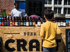 no drinks for you (jaumescar) Tags: street light boy color guy beer sunglasses yellow kid bottle day open market drink outdoor young craft tshirt sunny stall brand selling