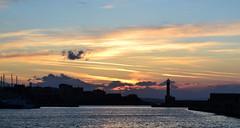 Hidden Sun. (Joka.) Tags: sunset lighthouse lines nikon skylines greece crete chania joka venetianport  d3100 nikond3100