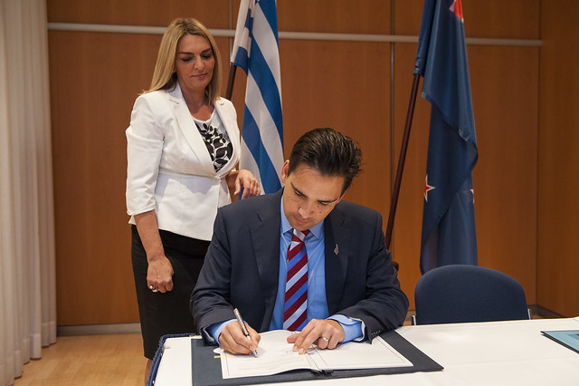 Simon Bridges signs the Air Service Agreement