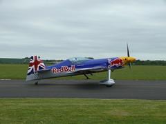 The Red Bull Matadors (Xtreme Air XA-41 - G-EVXA) (Gareth Can't Fly) Tags: red museum plane flying war display aircraft flight bull duxford imperial matadors aerobatic imperialwarmuseum iwm xtremeair xa41 gevxa