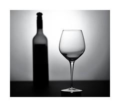 Bottle Of Wine (sorrellbruce) Tags: lighting bw stilllife glass monochrome glasses blackwhite bottle fuji dof wine minimal elegant manualfocus backlighting bottleofwine lr6 photoninja silverefexpro fujixt1 fujinon56mm petebridgwoodsharpeningpresets lightingglassware