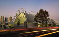 Ian Thorpe Aquatic Centre at Sunset (Orange Orb Photography) Tags: city sunset building architecture au sydney australia newsouthwales lighttrails ultimo swimmingcentre ianthorpeswimmingcentre