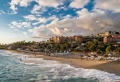 Tenerife April 2016 (2A) 080 - Sun setting on Playa de Duque and people are still out there (Mark Schofield @ JB Schofield) Tags: ocean sunset sea rescue mannequin architecture buildings island apartment playa atlantic collapse tenerife shops shoppingcenter volcanic teide loschristianos arona adeje loscristianos canaryisles fanabe plazadelduque roquedelconde