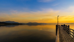Serenity (Bokehschtig (OFF)) Tags: sunset sea lake seascape mountains alps water clouds sunrise reflections pier sonnenuntergang sundown sony silhouettes bluehour chiemsee a7 cloudscape chieming bavariansea hausamsee sonya7 sel1635f4z