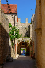 down a side street in hvar (Sam Scholes) Tags: stone hvar island adriatic sea travel street person photography home vacation europe brick croatia adriaticsea hvarisland streetphotography pitve splitskodalmatinskaupanija hr