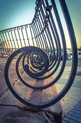 La verja redonda (Alicia Clerencia) Tags: street sunset summer village grill verano urbana pueblos ayamonte repetitions verja repeticiones atardece