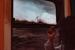 Untitled (elsableda) Tags: train lights wind sy girl smoking cigarette rain travel nature window light cloudy storm stormy morning road trip southafrica karoo africa traveling
