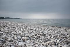 Peschiera 2 (PascallacsaP) Tags: italy lake beach water clouds italia gloomy empty pebbles serene minimalist tranquil lagodigarda veneto peschiera peschieradelgarda