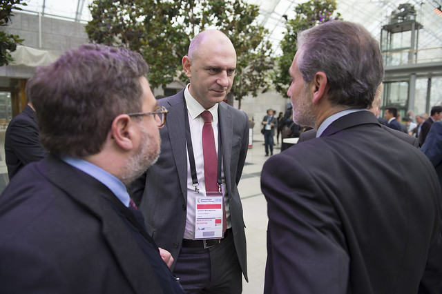 Vladimir Shulmeister speaking with other reception attendees