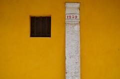 venice window 2 (justfloating) Tags: window yellow pillar numbers