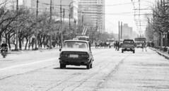 Pyongyang Taxi (Baron Reznik) Tags: road bw car horizontal blackwhite cab taxi streetscene korea transportation puto everydaylife northkorea sodo taxicab flatland pyongyang chosun changan dprk ryugyong pavedroad  democraticpeoplesrepublicofkorea        chosnminjujuiinminkonghwaguk canon28300mmf3556lisusm kisong   ryugyng pyeongyangjikhalsi hwangsong rakrang sgyong hogyong capitolofwillows pyngyangchikhalsi