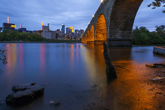 Stone Arch Bridge (Sam Wagner Photography) Tags: city bridge blue sunset sky mill water stone skyline night lights long exposure cityscape arch angle theatre dusk magic wide smooth ruin minneapolis wells hour scape fargo guthrie ids capella