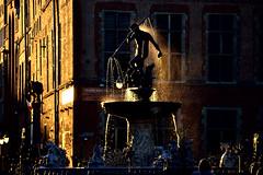 Neptune? Or maybe Vulcan? (przemnml) Tags: travel light sunset shadow sun monument water fountain shower gold nikon flickr poland polska hour polen traveling poseidon chiaroscuro danzig gdask neptun pomorze 18125 nikonsigma posejdon d3100 nikond3100