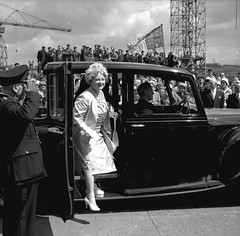 The Queen Mother arriving at Walker Naval Yard (Tyne & Wear Archives & Museums) Tags: door roof shadow people cloud abstract men industry window glass car wheel wall shirt buildings happy daylight interesting wire women uniform industrial ship shine dress unitedkingdom crane flag salute navy tie ground vessel pole cranes suit event button gathering trousers 1960s unusual launch pocket shipyard occasion tyneside crease crowds royalty radiant slope monarchy newcastleupontyne fascinating queenmother shipbuilding shiplaunch industrialheritage socialhistory northernstar passengership blackandwhitephotograph britishroyalfamily walkernavalyard navalyard northeastofengland passengerliner shipbuildingheritage maritimeheritage sirwgarmstrongwhitworthcoltd vickersarmstrongltd highwalker elswickshipyard 27june1961