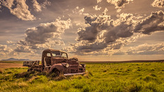Weight On Me (Wayne Stadler Photography) Tags: canada cars abandoned rural countryside rust farm country rusty alberta weathered trucks aged discarded prairies derelict automobiles southernalberta rustographer travelvehicles