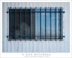 Barred Window (G Dan Mitchell) Tags: sanfrancisco california street sky urban usa reflection building window metal america pier waterfront interior north cage barred