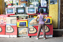 The Viewer (phil.w) Tags: old boy india man color television shirt tv crt looking pentax market watching stack tvs colourful limited kolkata striped calcutta shopkeeper hogg sudder smcpfa31mmf18