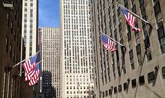 Rockefeller Plaza (www.toprq.com/iphone) Tags: street plaza new york city travel urban usa ny building architecture america cityscape time manhattan united flags warner states rockefeller esso 500px