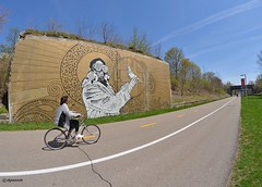 Zooming By (FrogLuv) Tags: bike bicycle graffiti candid streetphotography murals detroitmichigan dequindrecut inexplore hygienicdressleague