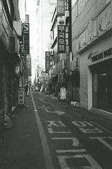 Street Scene - Busan (Shoji Kawabata. a.k.a. strange_ojisan) Tags: street city bw white black film analog 35mm asia cityscape cityscapes delta s scene korea busan fujifilm 3200 ilford analogphotography bnw klasse eastasia analogphoto filmphotography filmphoto