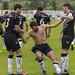 Turegano y Pantiga levantando al autor del gol