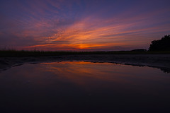 Cast Your Regrets Upon The Sea Of Flame (J Swanstrom (In & Out For A While)) Tags: sunset sky cloud reflection beach water colors georgia landscape puddle evening coast nikon outdoor vibrant vivid shore d750 savannah rodneyjhallboatramp jswanstromphotography