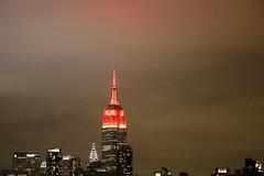 Red Empire State Building (apardavila) Tags: nyc newyorkcity skyline clouds skyscraper manhattan empirestatebuilding chryslerbuilding