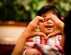 Little Love (faizalakbar) Tags: 2 love smile canon mom eos 50mm dad heart mark father 14 mother mohammed ii 7d doha qatar faizal