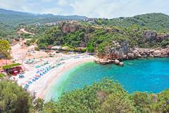 Ka byk akl plaj (Antalya) (talipcetin) Tags: sea summer cliff sun holiday tree beach nature turkey big sand woods crystal trkiye large grand clear pebble antalya transparent deniz kum gravel crag kumsal ka plaj akl