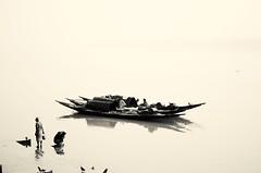Monochrome Morning (Chiradeep.) Tags: morning india monochrome misty fog river fisherman oldman fishingboat ganga ganges waterscape westbengal foggymorning oldperson
