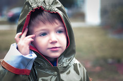 Where the hood at? (Luke Vincent Photographer) Tags: family boy playing face rain childhood closeup fun outside outdoors child play son hood raincoat