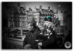 Bagpiper performs music on the Westminster bridge, London, United Kingdom (KS Photography!) Tags: street city travel bridge england blackandwhite bw musician music irish black london castle nature westminster architecture 35mm person scotland blackwhite costume nikon uniform play unitedkingdom britain traditional pipes culture streetphotography highlander scottish londoneye skirt tourist historic equipment highland musical streetartist instrument editorial classical piper tradition nikkor musicalinstrument bandw performer riverthames nikondigital bagpiper attraction selective bagpipe caucasian selectivecolor sporran scotsman streetsoflondon greaterlondon thepipes aerophones greathighlandbagpipes 35mmf18g asetofpipes astandofpipes