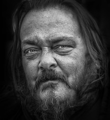 Joe -- b/w (andy_8357 (mostly away)) Tags: sel55210 sony a6000 joe mirrorless ilce6000 nex ilcenex boulder pearl street mall colorado bw beard penetrating eyes classic character large man piercing powerful mustashe shakespearean dramatic photography blancoynegro