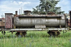 Some water... (henryark) Tags: outdoor railroad rails vehicle locomotive wagon container water iron steel wheels bolts screws gears rust rusty old vintage historic deposit museum grass green grey sky tree clouds pistoia tuscany italy enriconannini nikon nikond750 nikonclubit