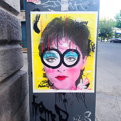 Stay Beautiful (Exile on Ontario St) Tags: street woman streetart art beautiful yellow mailbox jaune postes circle print poster graffiti glasses eyes poste artist montreal circles madonna femme ripped sidewalk 80s singer torn entertainer letterbox oldmontreal eighties damaged 1980s lunettes spectacles stay posterart trottoir courrier canadapost vieuxmontral annes80 postescanada staybeautiful