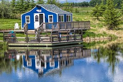 The blue cottage (hey ~ it's me lea) Tags: blue lake reflections cottage ellisbirdfarm