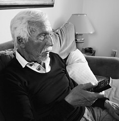 Toni with remote control (judydeanclasen) Tags: portrait bw remotecontrol tannedskin olderguy