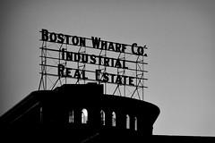 Give Me a Reason (Thomas Hawk) Tags: bw usa boston neon realestate unitedstates massachusetts unitedstatesofamerica newengland beantown fav10 fav25 bostonwharfco